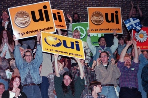 Yes supporters cheer during a speech by Bloc Quebecois Leader Lucien Bouchard at a junior college in Montreal Tuesday, Oct. 24, 1995. (Ryan Remiorz/ THE CANADIAN PRESS)