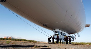 FILE: Ground crew members prepare the U.S. Navy blimp MZ-3A for take-off in Lakehurst, N.J., in this 2012 file photo. (AP / Mel Evans)