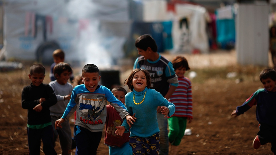 Syrian refugee boys play at a refugee camp in the town of Hosh Hareem, in the Bekaa valley, east Lebanon, Wednesday, Oct. 28, 2015. (AP / Hassan Ammar)