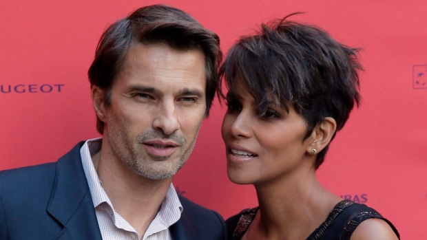In this June 13, 2013 photo, actor and president of the Champs-Elysees Film Festival Olivier Martinez, left, poses with actress Halle Berry. (AP / Francois Mori)