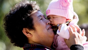 China's ruling Communist Party announced in Oct. 2015 that the country will start allowing all couples to have two children, abolishing an unpopular policy that limited many urban couples to only one child for more than three decades.  (AP / Andy Wong)