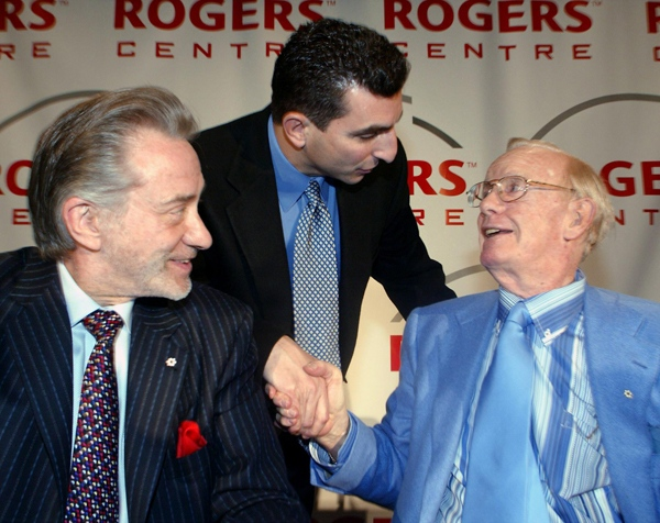 Toronto Blue Jays GM J.P. Ricciardi, centre, greets Rogers Communications President and CEO Ted Rogers, right, and Toronto Blue Jays President and CEO Paul Godfrey, left. following a news conferencee in Toronto on Wednesday, Feb. 2, 2005. Rogers announced the renaming of the SkyDome to Rogers Centre and an increase in team payroll to US$210 million over three years at the news conference. (Frank Gunn / THE CANADIAN PRESS)