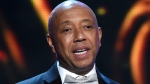 In this Feb. 6, 2015, file photo, hip-hop mogul Russell Simmons presents the Vanguard Award on stage at the 46th NAACP Image Awards in Pasadena, Calif.  (Chris Pizzello/Invision/AP)
