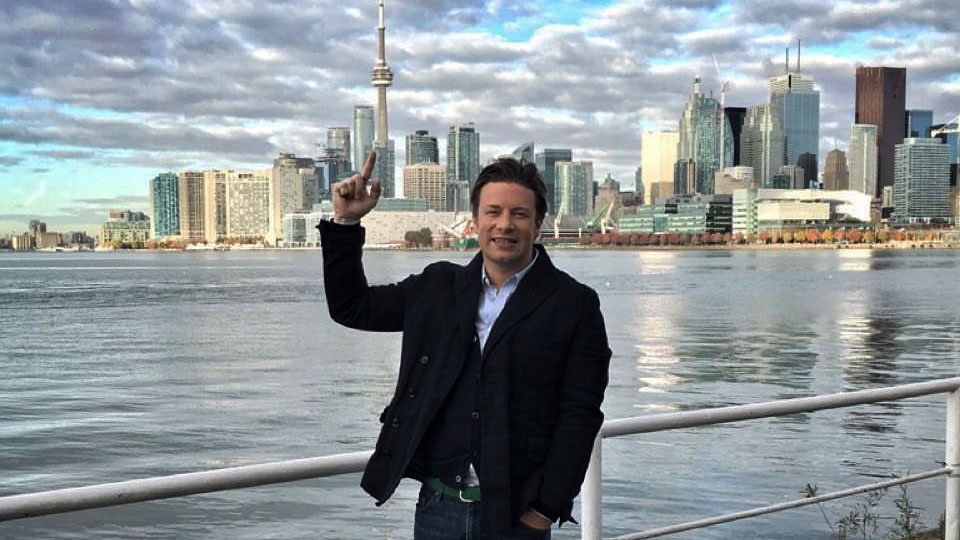Jamie Oliver poses in front of the Toronto skyline on Oct. 26, 2015.