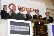 NYSE Chief Executive Officer, John Thain, third left, joins Rogers Communications, Inc., Founder, President and CEO Ted Rogers, fourth left, and others for the opening bell at the New York Stock Exchange, Thursday, March 2, 2006. (AP / Mel Nudelman)