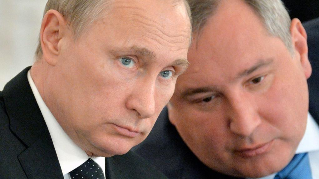 Vladimir Putin, left, and Dmitry Rogozin