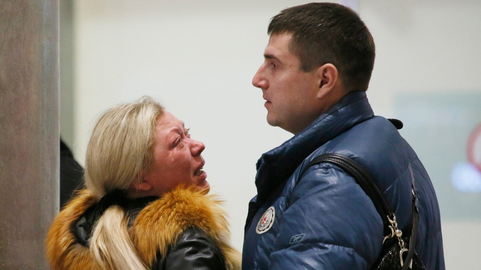 Relatives react after a Russian airliner with 217 passengers and seven crew aboard crashed, as people gather at Russian airline Kogalymavia's information desk at Pulkovo airport in St.Petersburg, Russia, Saturday, Oct. 31, 2015. (AP / Dmitry Lovetsky)