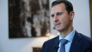 In this Sunday, Oct. 4, 2015 file photo released by the Syrian official news agency SANA, shows Syrian President Bashar Assad, speaking during an interview with the Iran's Khabar TV, in Damascus, Syria. (SANA via AP, File)
