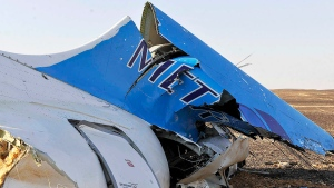 The tail of a Metrojet plane that crashed in Hassana Egypt is seen Friday, Oct. 31, 2015. (Suliman el-Oteify / Egypt Prime Minister's Office)