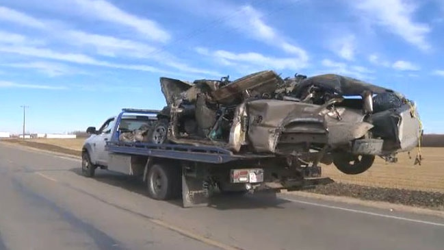 The pick-up truck involved in a triple fatal crash is towed from the scene. (Breanna Karstens-Smith / CTV Edmonton)