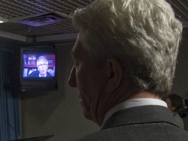 Bloc Qu�b�cois leader Gilles Duceppe watches as Liberal leader Stephane Dion reacts to Prime Minister Stephen Harper's televised speech to the nation on Parliament Hill in Ottawa on Wednesday Dec.3, 2008. (Adrian Wyld / THE CANADIAN PRESS)