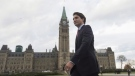Prime Minister-designate Justin Trudeau walks to a news conference from Parliament Hill in Ottawa, on October 20, 2015. A rare phenomenon is transpiring in a foreign capital where mentioning Canadian politics is generally about as likely to stimulate conversation at a dinner party as to get you disinvited from the next one.People are curious about Canada's next prime minister. THE CANADIAN PRESS/Adrian Wyld