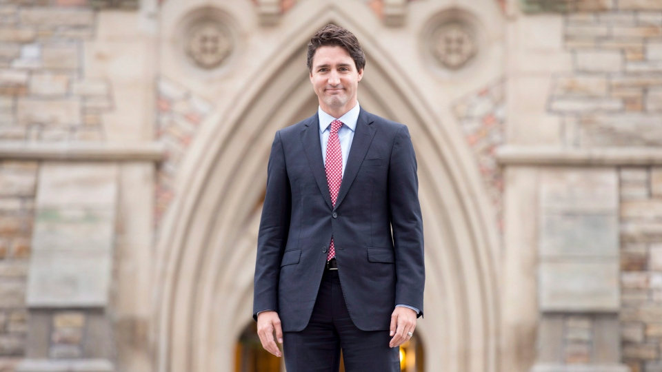 Prime minister designate Justin Trudeau walks to a news conference from Parliament Hill in Ottawa on Oct. 20, 2015. (THE CANADIAN PRESS/Adrian Wyld)