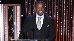 """Will Smith accepts the Hollywood actor award for """"Concussion,"""" at the Hollywood Film Awards at the Beverly Hilton Hotel in Beverly Hills, Calif. on Sunday, Nov. 1, 2015. (Chris Pizzello / Invision)"""