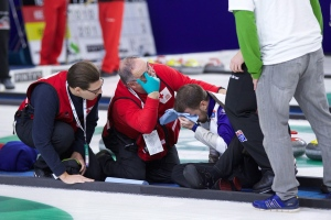 Curler Brad Gushue is attended to by medical personnel after falling in a match Oct. 31, 2015. He suffered a concussion. Curling Canada announced a new concussion protocol Friday. (File/THE CANADIAN PRESS)