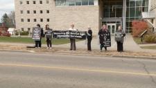 Protest outside Pembroke court.
