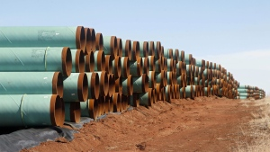 Miles of pipe for the stalled Canada-to-Texas Keystone XL pipeline are stacked in a field near Ripley, Okla. on Feb. 1, 2012. (Sue Ogrocki / THE CANADIAN PRESS)