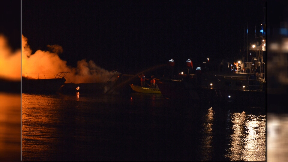 Volunteer firefighters and the Coast Guard responded to a pair of boat fires in Cowichan Bay that police have deemed suspicious. Oct. 31, 2015. (CTV Vancouver Island)