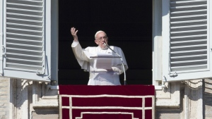Pope Francis delivers his blessing during the Angelus noon prayer he celebrated from the window of his studio overlooking St. Peter's Square, at the Vatican on Sunday, Nov. 1, 2015. (AP / Andrew Medichini)