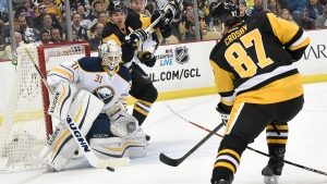 Buffalo Sabres goalie Chad Johnson (31) makes a save against Pittsburgh Penguins centre Sidney Crosby (87), on Oct. 29, 2015. (Don Wright / AP)
