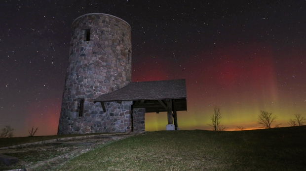 The Northern Lights shine over Pilot Knob State Park near Forest City, Iowa, in the early morning of Tuesday, Nov. 3, 2015. (Bryon Houlgrave/The Des Moines Register/AP)