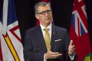 Newfoundland and Labrador Premier Paul Davis takes a question from a reporter during a visit to the Ontario legislature in Toronto on March 3, 2015. (THE CANADIAN PRESS / Chris Young)