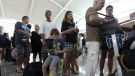 Passengers line up to check the status of their flights with airline desk at Ngurah Rai International Airport in Bali, Indonesia on Wednesday, Nov. 4, 2015. (AP / Firdia Lisnawati)