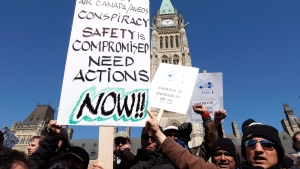 Locked-out Aveos maintenance workers, who maintained Air Canada aircraft, protest on Parliament Hill in Ottawa, Tuesday March 27, 2012. (THE CANADIAN PRESS/Fred Chartrand)