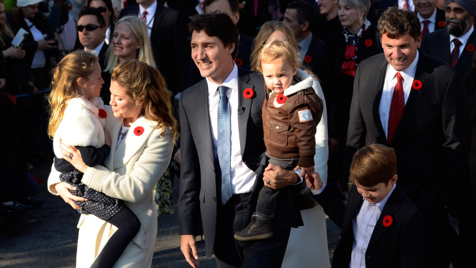 Justin Trudeau, his wife Sophie Gregoire-Trudeau and their children Ella-Grace, Hadrien and Xavier lead the new Liberal cabinet to Rideau Hall in Ottawa on Wednesday, Nov. 4, 2015. (Sean Kilpatrick / THE CANADIAN PRESS)