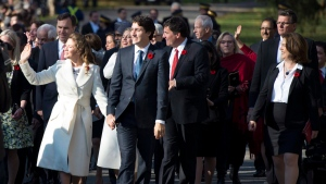 Prime Minister-designate Justin Trudeau, his wife Sophie Gregoire-Trudeau and the Members of Parliament who will comprise his cabinet arrive at Rideau Hall in Ottawa on Wednesday, Nov. 4, 2015. (Justin Tang / THE CANADIAN PRESS)