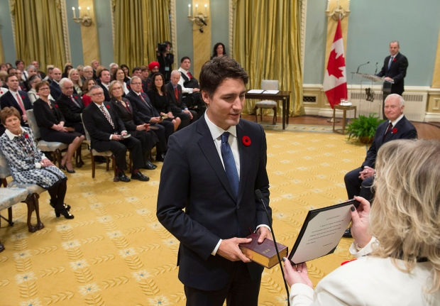 Prime Minister Justin Trudeau takes the oath of office at Rideau Hall in Ottawa on Wednesday, November 4, 2015. (Sean Kilpatrick / THE CANADIAN PRESS)