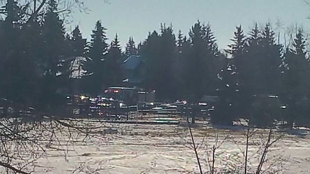 Ambulances are seen at Woodlands School in southwest Calgary after a gas leak was detected at the building. (Photo: Vicky Sutherland)