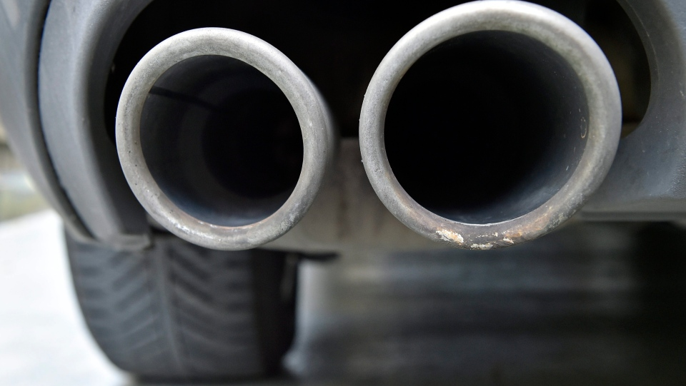 The exhaust pipes of an up to date Audi car blow out emissions during the engine start in Gelsenkirchen, Germany, Wednesday, Nov. 4, 2015. (AP/Martin Meissner)