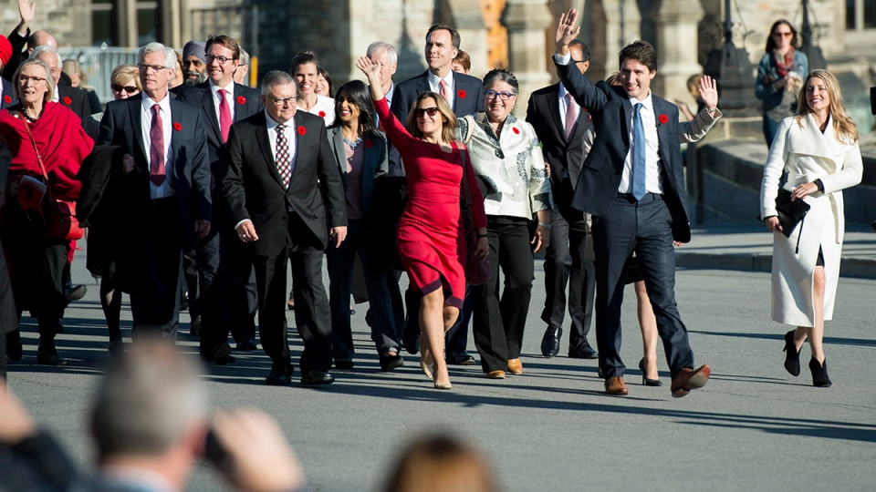 Prime Minister Justin Trudeau waves to onlookers as he arrives on Parliament Hill with his newly sworn-in cabinet ministers, in Ottawa on Wednesday, Nov. 4, 2015. (Justin Tang / THE CANADIAN PRESS)