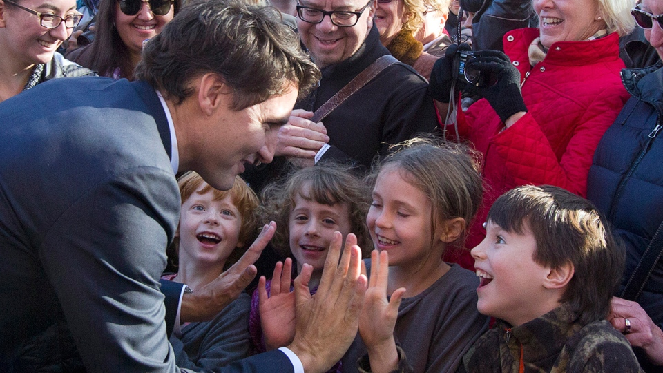 Prime Minister Justin Trudeau gives a high five to children after attending a swearing-in ceremony of his cabinet at Rideau Hall in Ottawa, Wednesday, Nov. 4, 2015. (Fred Chartrand / THE CANADIAN PRESS)