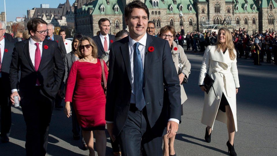 Prime Minister Justin Trudeau and his newly sworn-in cabinet ministers arrive on Parliament Hill in Ottawa on Wednesday, Nov. 4, 2015. (Justin Tang / THE CANADIAN PRESS)