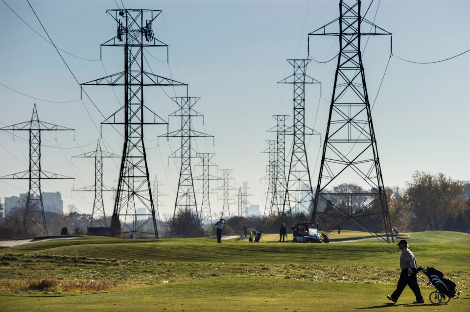 Hydro towers are seen over a golf course in Toronto on Wednesday, November 4, 2015. (Darren Calabrese / THE CANADIAN PRESS)