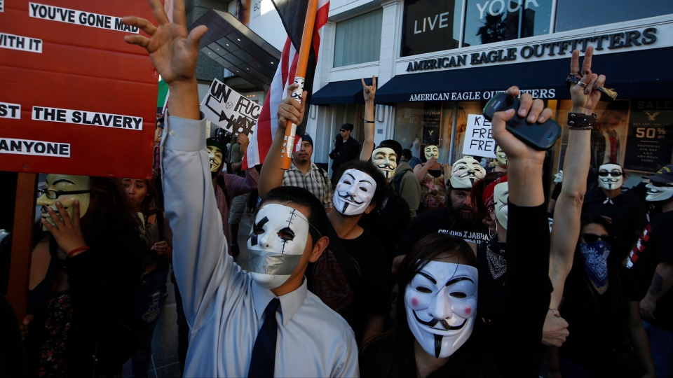 Protesters rally in an anti-police-brutality protest in the Hollywood district of Los Angeles, Wednesday, Nov. 5, 2014. (AP / Damian Dovarganes)