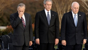 In this Friday, Dec. 15, 2006, file photo, U.S. secretary of defense Donald Rumsfeld, left, pauses as former U.S. president George W. Bush, and vice president Dick Cheney participate in Rumsfeld's farewell ceremony at the Pentagon in Washington. (AP Photo/J. Scott Applewhite, File)