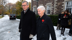 Premier Paul Davis leaves Government House with his wife Cheryl after meeting with Lt. Gov. Frank Fagan to call an election in Newfoundland and Labrador, Thursday, Nov.5, 2015. (Keith Gosse / THE CANADIAN PRESS)