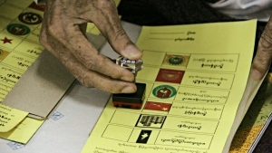 A man stamps his early ballot at Hnin Si Kone Old Aged Center in Yangon, Myanmar on Friday, Nov 6, 2015. (AP / Khin Maung Win)
