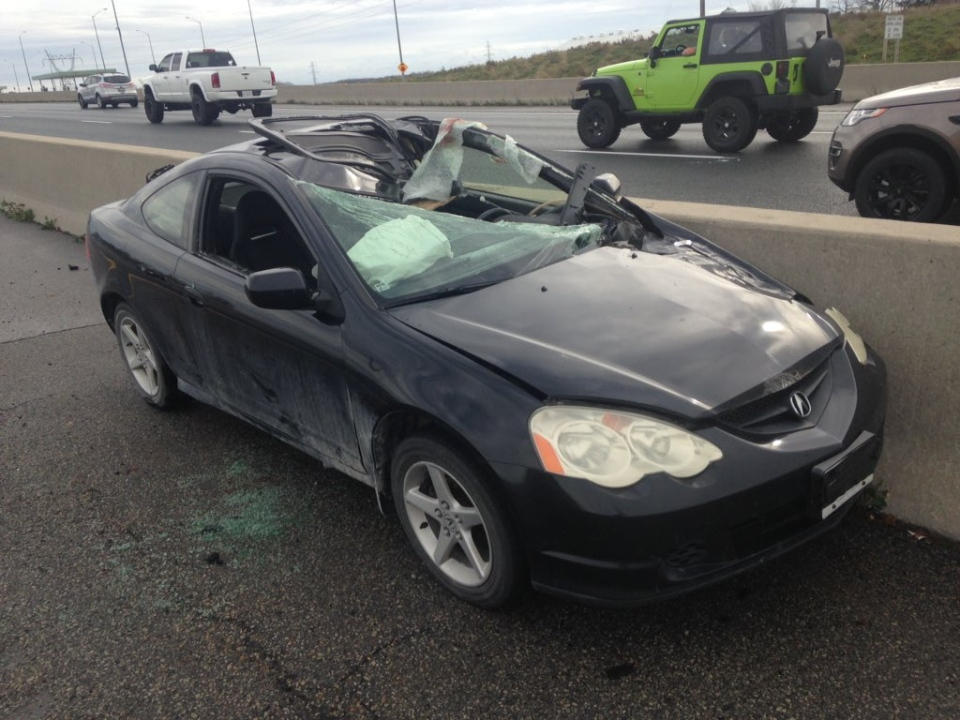 A car struck by a truck tire that killed the driver is seen on Highway 401 near Putnam, Ont., on Friday, Nov. 6, 2015. (Gerry Dewan / CTV London)