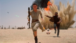 """This photo provided by Disney shows Daisey Ridley as Rey, left, and John Boyega as Finn, in a scene from the new film, """"Star Wars: The Force Awakens. (Film Frame/Disney/Lucasfilm via AP)"""