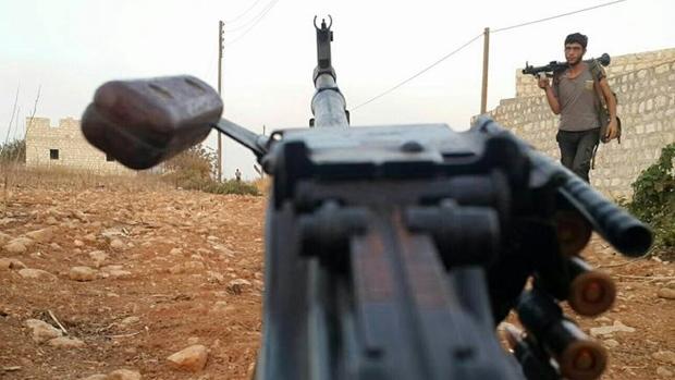Free Syrian Army fighter in Azzan, Syria