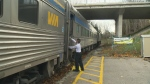 Luggage is unloaded from a Via Rail train in St. Marys, Ont., on Friday, Nov. 6, 2015.