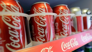 Cans of Coca-Cola sit in a refrigerator in San Francisco, on June 30, 2014. (AP Photo/Jeff Chiu)