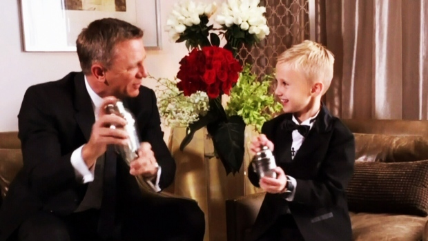 James Bond superfan Britton Walker, 8, from Calgary mixes an apple martini with actor Daniel Craig before the premiere of 'Spectre' in Mexico City.