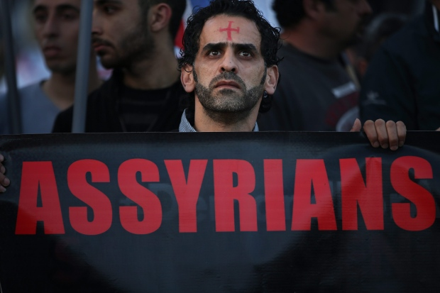 Assyrian man protests Christian abductions