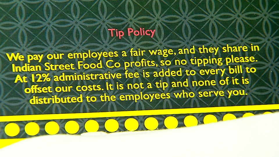 A note inside the menu at the Indian Street Food Co. explains the restaurant's tipping policy.