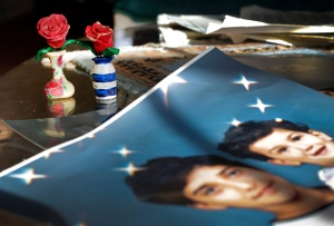 In this Dec. 10, 2014 file photo, artwork created by Adnan Syed sits near family photos in the home of his mother, Shamim Syed, in Baltimore. (AP / Patrick Semansky)